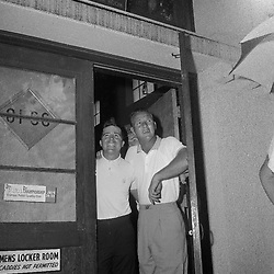 Golfer Gary Player and Arnold Palmer didn't get a chance to tee off before the rain started. Here they are peeking out the club house door on July 28, 1961 a tthe PGA Tournament at Olympia Fields.