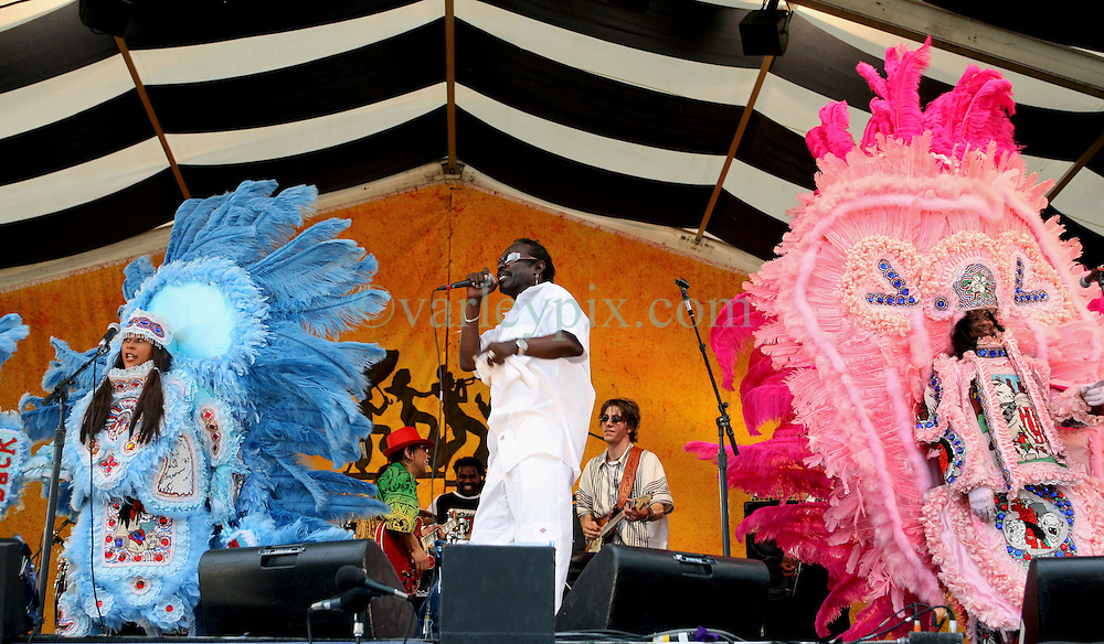 "07 May 2006. New Orleans, Louisiana. The New Orleans Jazz and Heritage festival. Big Chief Bo Dollis of the Wild Magnolias Mardi Gras Indians (mid). Bo Dollis left hospital following illness just a month prior to the festival.<br /> Big Chief Theodore ""Bo"" Dollis, who led the Wild Magnolia tribe of Mardi Gras Indians in performances around the world passed away January 20th, 2015. He was 71.<br /> Photo; Charlie Varley/varleypix.com"