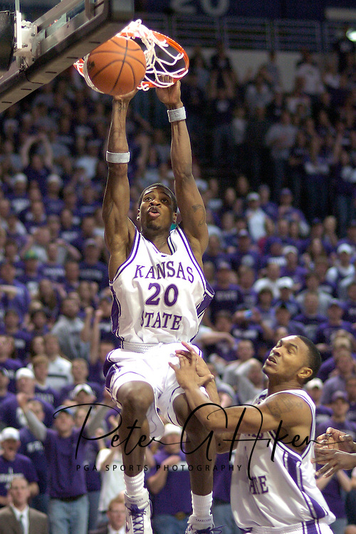 Kansas State forward Cartier Martin (20) slams the ball over teammate Lance Harris (lower right) during the Wildcats second half come back over Colorado at Bramalage Coliseum in Manhattan, Kansas, February 18, 2006.  K-State won 72-60.