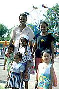 African American parents age 30 at Grand Old Day festival with kids ages 3 through 7.  St Paul Minnesota USA