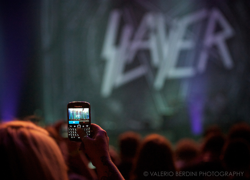 A fan uses a mobile camera to snap a photo of a concert. ATP I'll Be Your Mirror Day 1<br />