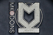Milton Keynes Dons logo embroided on team seats during the EFL Cup match between Milton Keynes Dons and Liverpool at stadium:mk, Milton Keynes, England on 25 September 2019.