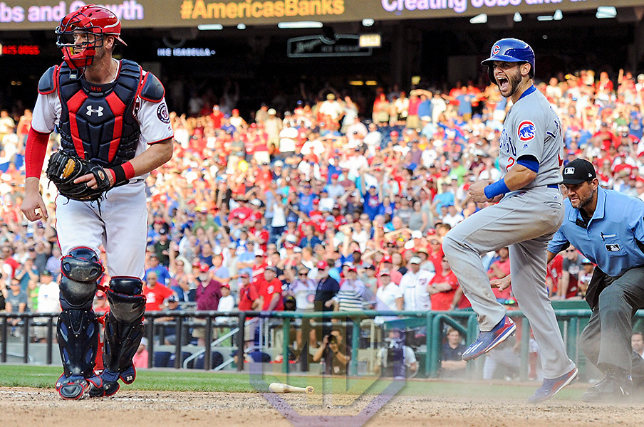 WASHINGTON, DC - JUNE 29: Chicago Cubs second baseman Tommy La Stella (2) reacts after scoring the winning run in the ninth inning ahead of the throw to Washington Nationals catcher Matt Wieters (32) during an MLB game between the Chicago Cubs and the Washington Nationals on June 29, 2017, at Nationals Park in Washington, D.C.  The Chicago Cubs defeated the Washington Nationals, 5-4. (Photo by Mark Goldman/Icon
