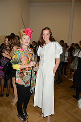 Left to right, VICTORIA GRANT and BRITA FERNANDEZ SCHMIDT at a private view and auction of millinery organised by author, philanthropist and hat collector Eva Lanska in aid of Women for Women International held at Pace, Burlington Gardens, London on 10th June 2015.