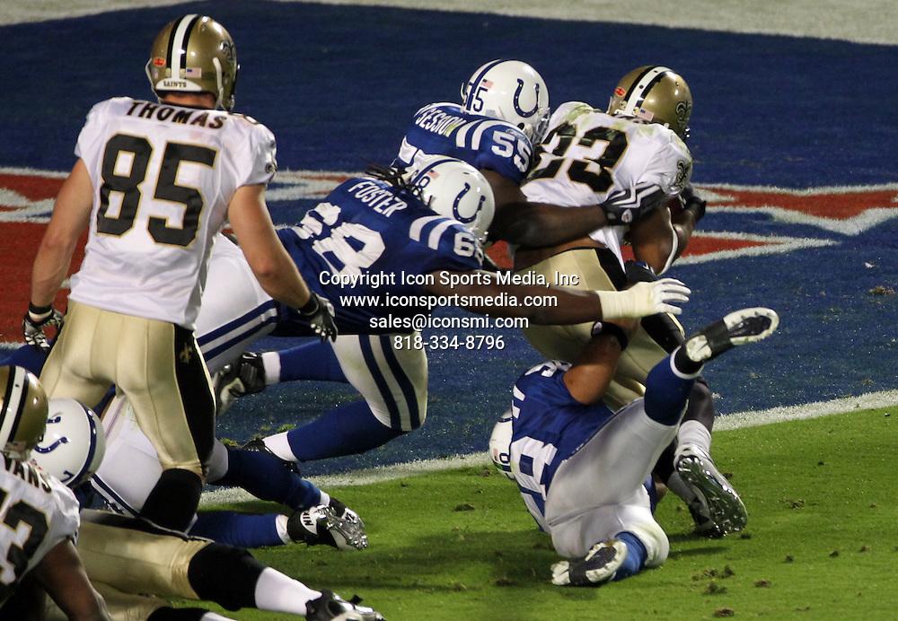 Feb. 07, 2010 - Miami Gardens, Florida, USA - The Saints PIERRE THOMAS is stopped near the goaline at Super Bowl XLIV at Sun Life Stadium