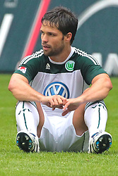 28.08.2010, Volkswagen Arena, Wolfsburg, GER, 1.FBL,  VfL Wolfsburg vs FSV Mainz 05, im Bild Diego ( Wolfsburg #28 ) sitzt auf dem Rasen  EXPA Pictures © 2010, PhotoCredit: EXPA/ nph/  Rust+++++ ATTENTION - OUT OF GER +++++