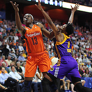 UNCASVILLE, CONNECTICUT- JULY 15:  Chiney Ogwumike #13 of the Connecticut Sun shoots past Alana Beard #0 of the Los Angeles Sparks during the Los Angeles Sparks Vs Connecticut Sun, WNBA regular season game at Mohegan Sun Arena on July 15, 2016 in Uncasville, Connecticut. (Photo by Tim Clayton/Corbis via Getty Images)