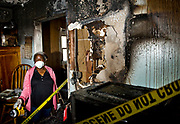 Dottie Mulkey, 74, walks through her damaged kitchen in Santa Ana after a December fire. Mulkey's homeowner's insurance had lapsed at the time of the blaze leaving her unable to restore her home.<br /> <br /> ///ADDITIONAL INFORMATION: mulkeyfire.0211 &ndash; 2/10/15 &ndash; NICK AGRO, ORANGE COUNTY REGISTER-BACKGROUND:<br /> Dorothy &quot;Dottie&quot; Mulkey, a local civil rights hero for the role she and her husband played in fighting housing discrimination in the 1970s, had a fire at her Santa Ana home in December. It destroyed her kitchen, and other parts of the house suffered smoke and water damage. Her homeowner's insurance had lapsed, leaving Mulkey, 74, unable to restore her home. She's retired and has been living with relatives and friends since the fire, but is determined to fix her home, even if she has to go back to work. Local documentary filmmaker Eli Reyna has started an online funding campaign to help raise money. We'll be photographing Mulkey at her damaged home.