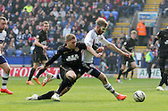 Wigan Athletic's Martyn Waghorn challenges Bolton's Tim Ream for the ball. Skybet football league championship match , Bolton Wanderers v Wigan Athletic at the Reebok stadium in Bolton on Saturday 29th March 2014.<br /> pic by David Richards, Andrew Orchard sports photography.