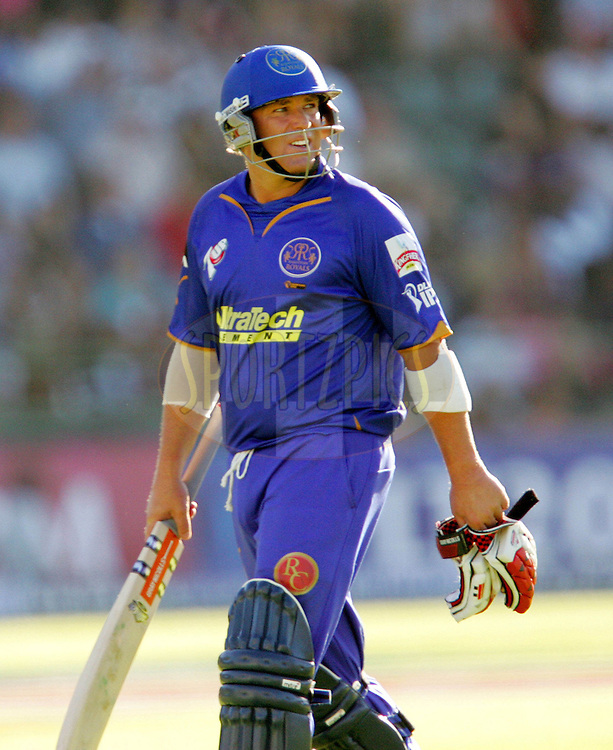 PORT ELIZABETH, SOUTH AFRICA - 02 May 2009. Shane Warne leaves, caught by Adam Gilchrist during the  IPL Season 2 match between the Deccan Chargers and the Rajatshan Royals held at St Georges Park in Port Elizabeth , South Africa..