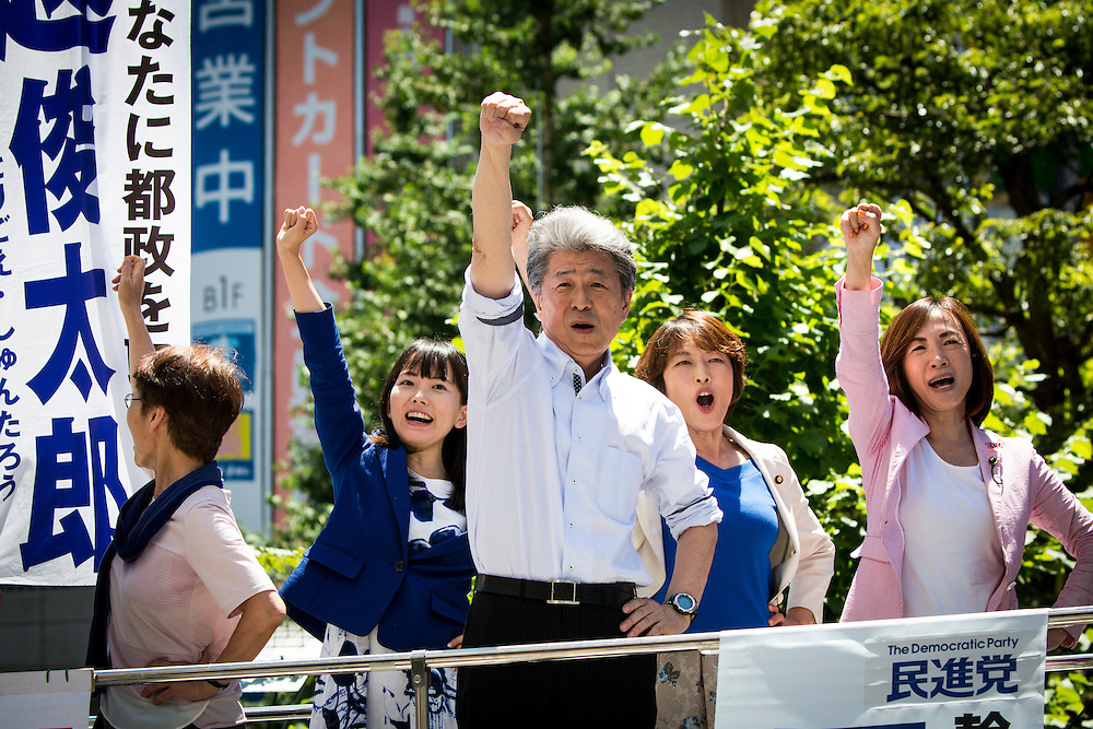 TOKYO, JAPAN - JULY 30 : Journalist Shuntaro Torigoe, a candidate for Tokyo governor and his team raised their fists together after the speech during the last day of Tokyo Gubernatorial Election campaign rally at Hachiōji Station, Tokyo, Japan on Saturday, July 30, 2016. Tokyo residents will vote on July 31 for a new Governor of Tokyo who will deal with issues related to the hosting of the Tokyo Summer Olympics and Paralympics in 2020. (Photo: Richard Atrero de Guzman/NUR Photo)