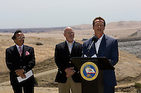 GUSTINE, CA - JULY 16:  California Governor Arnold Schwarzenegger speaks during a press conference at the San Luis Reservoir on July 16, 2007 in Gustine California. The governor stressed the importance of a comprehensive water plan as the current system is not prepared to handle the population growth projected for the next 50 years. The reservoir which is filled to just 20.797 percent of capacity and is down 186 feet from normal levels supplies water for the Silicon Valley, Central Valley farms and Southern California homes and businesses.  (Photograph by David Paul Morris)