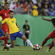 FOXBOROUGH, MASSACHUSETTS - JUNE 12:  Lucas Lima #10 of Brazil and Oscar Vilchez #16 of Peru challenge for the ball during the Brazil Vs Peru Group B match of the Copa America Centenario USA 2016 Tournament at Gillette Stadium on June 12, 2016 in Foxborough, Massachusetts. (Photo by Tim Clayton/Corbis via Getty Images)