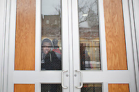 3 February, 2009. New York, NY. A student looks outside the main entrance door of the Louis D. Brandeis High School in the Upper West Side. Brandeis High School will be closed by the City in order to have smaller high schools.<br /> <br /> ©2009 Gianni Cipriano for The New York Times<br /> cell. +1 646 465 2168 (USA)<br /> cell. +1 328 567 7923 (Italy)<br /> gianni@giannicipriano.com<br /> www.giannicipriano.com