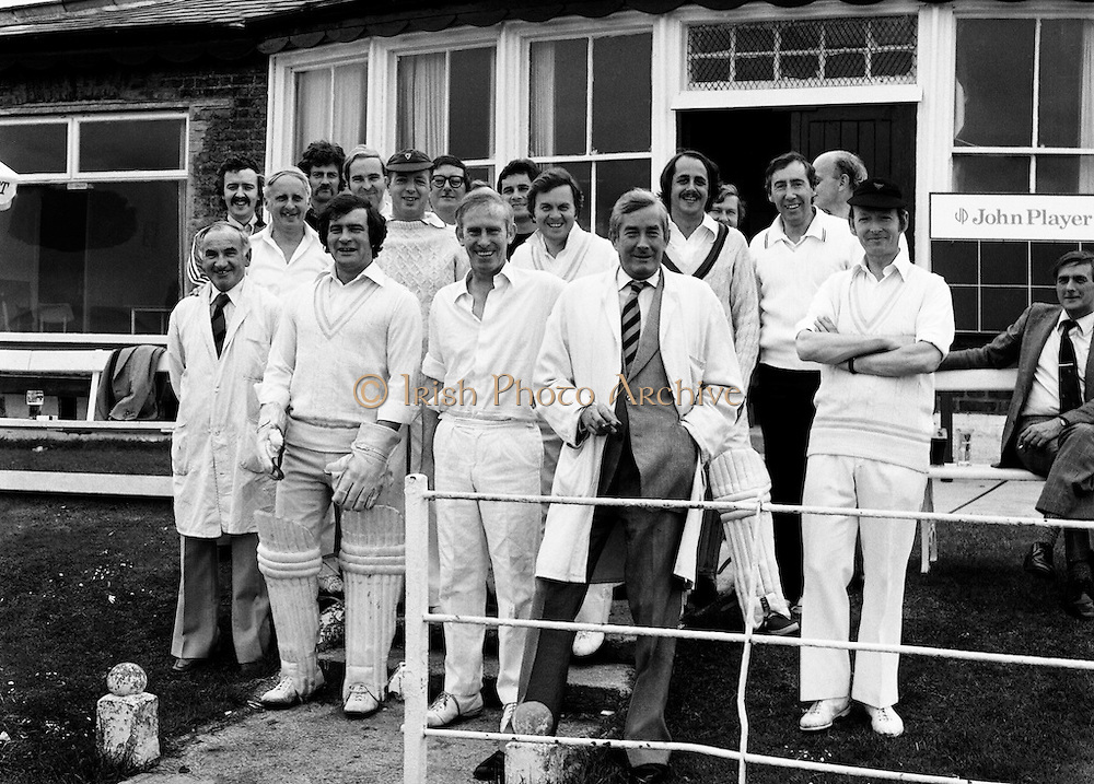 A cricket match between members of the Press and RTE personnel at the Phoenix Club. Among the well-known faces are Fred Cogley, (in cap and Aran jumper); next to him is the tenor Frank Patterson and second from right, second row, is newsreader Jim Sherwin.<br /> 18/07/1978