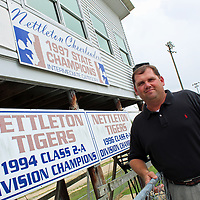 Coach turned principal Justin Hollis began his first year leading Nettleton High School July 1. As signs on the school's press box illustrate championship wins in athletics, he plans to bring academic wins to the school.