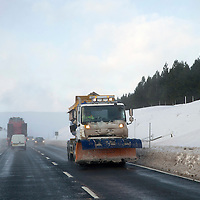 Weather Pics..16.01.15<br /> A snow plough covered in snow and ice makes it's way down the A9 near Dalwhinnie as the forecast predicts more snow and ice over the next few days<br /> Picture by Graeme Hart.<br /> Copyright Perthshire Picture Agency<br /> Tel: 01738 623350  Mobile: 07990 594431