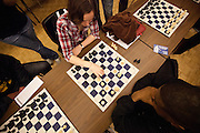 Sam Peek, Senior Chemical Forensic Science, and Myles Eluka, Senior Criminal Justice and Sociology, play chess at the Human Rights Lecture in the Barrett Ballroom at the Student Union, San Jose State University, San Jose, Calif., on March 21, 2012.  Photo by Stan Olszewski/Spartan Daily