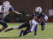 Cedar Ridge's Charles Porter (1) gets brought down by Hendrickson's Chance Waz Friday night at Dragon Stadium.  The Raiders lost to the Hawks 35-28.