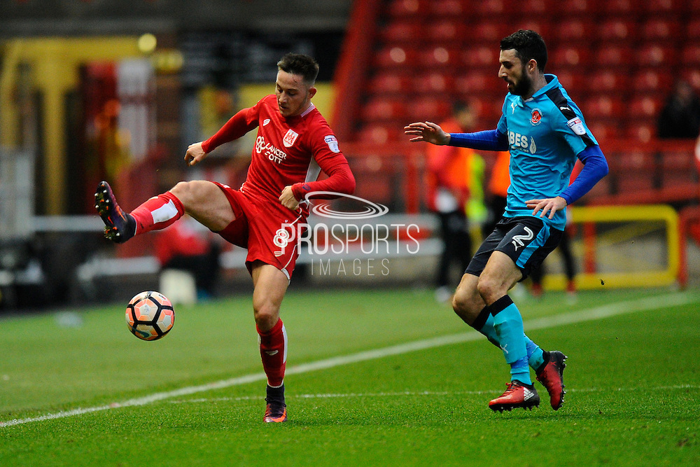 Josh Brownhill (8) of Bristol City and Conor McLaughlin (2) of Fleetwood Town during the The FA Cup match between Bristol City and Fleetwood Town at Ashton Gate, Bristol, England on 7 January 2017. Photo by Graham Hunt.