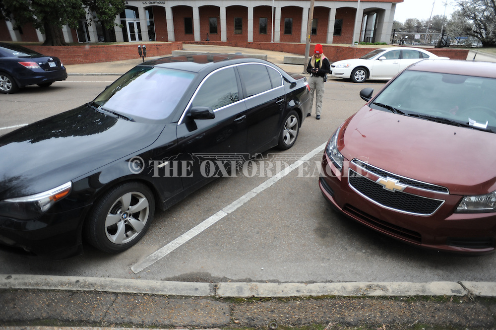 Reserve officer Lauren Develle enforces overtime parking, in Oxford, Miss. on Saturday, March 28, 2015.