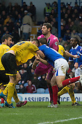 Jake Goodman, Paul Robinson, Paul Jones clash during the Sky Bet League 2 match between Portsmouth and AFC Wimbledon at Fratton Park, Portsmouth, England on 26 December 2014. Photo by Stuart Butcher.