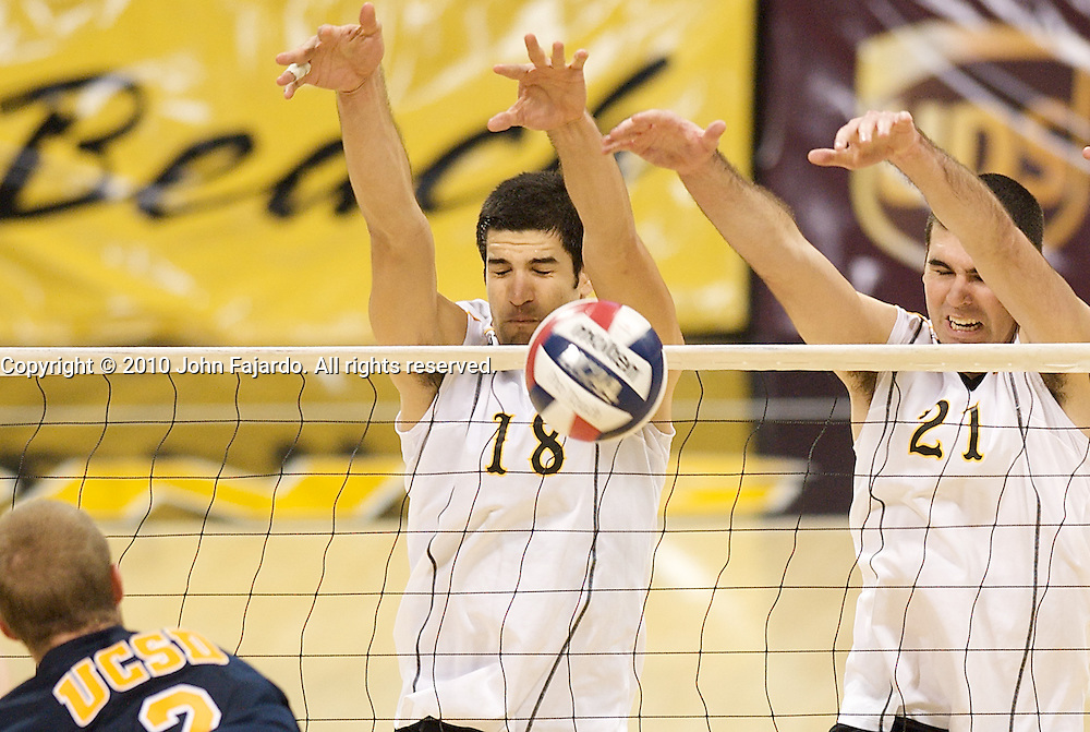 Dean Bittner(18) and Dan Alexander(21) put up the block in the match against U.C. San Diego at the Walter Pyramid, Long Beach CA, Friday, Jan. 29, 2010.  The 49ers win in three straight sets, 30-22, 30-22, 30-21.