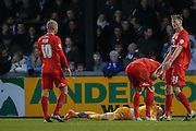 York City goalkeeper Scott Flinders  lies injured  during the Sky Bet League 2 match between Bristol Rovers and York City at the Memorial Stadium, Bristol, England on 12 December 2015. Photo by Simon Davies.