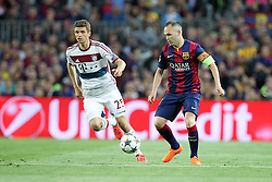 06.05.2015, Camp Nou, Barcelona, ESP, UEFA CL, FC Barcelona vs FC Bayern Muenchen, Halbfinale, Hinspiel, im Bild l-r: im Zweikampf, Aktion, mit Thomas Mueller #25 (FC Bayern Muenchen) und Andres Iniesta #8 (FC Barcelona) // during the UEFA Champions League semi finals 1st Leg match between FC Barcelona and FC Bayern Munich at the Camp Nou in Barcelona, Spain on 2015/05/06. EXPA Pictures © 2015, PhotoCredit: EXPA/ Eibner-Pressefoto/ Kolbert<br /> <br /> *****ATTENTION - OUT of GER*****