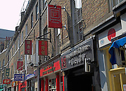 Signs for Chinese restaurants, Chinatown, London, England