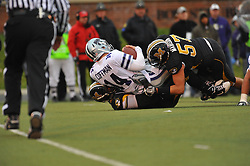 Nov 13, 2010; Columbia, MO, USA; Kansas State Wildcats quarterback Carson Coffman (14) is sacked by Missouri Tigers defensive lineman Brad Madison (57) and defensive end Aldon Smith (85) in the second half at Memorial Stadium. Missouri won 38-28.  Mandatory Credit: Denny Medley-US PRESSWIRE