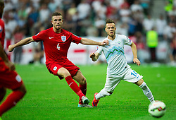 Jordan Henderson of England vs Dejan Lazarevic of Slovenia during the EURO 2016 Qualifier Group E match between Slovenia and England at SRC Stozice on June 14, 2015 in Ljubljana, Slovenia. Photo by Vid Ponikvar / Sportida