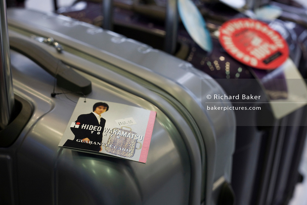 Hideo Wakamatsu Suitcases on sale at the Excess Baggage' shop in departures at Heathrow airport's terminal 5. .