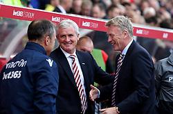 Stoke City manager Mark Hughes and Sunderland manager David Moyes smile during the prematch handshakes - Mandatory by-line: Robbie Stephenson/JMP - 15/10/2016 - FOOTBALL - Bet365 Stadium - Stoke-on-Trent, England - Stoke City v Sunderland - Premier League