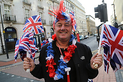 © Licensed to London News Pictures. 28/09/2016. Leeds, UK. A man waves union jack flags during the Olympic and Paralympic parade in Leeds. Yorkshire's Olympic and Paralympic stars receive a heroes' welcome during an open top bus parade in Leeds, West Yorkshire.  Photo credit : Ian Hinchliffe/LNP