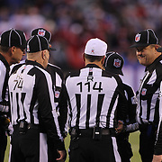 Referees discuss a call during the New York Giants V San Francisco 49ers, NFL American Football match at MetLife Stadium, East Rutherford, NJ, USA. 16th November 2014. Photo Tim Clayton