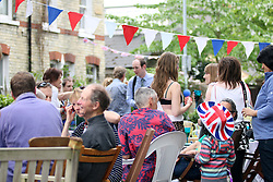 Cambridge, UK  29/04/2011. The Royal Wedding of HRH Prince William to Kate Middleton. Street Party with young an old on Belvoir Road Cambridge city centre. The party was not official as planning had been refused. Photo credit should read Jason Patel/LNP. Please see special instructions. © under license to London News Pictures