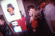 A couple kiss at Chibuku Shake Shake, Liverpool, U.K, 1990s.