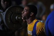 squats during Class 5A Region weightlifting competition at Oxford High School in Oxford, Miss. on Saturday, February 9, 2013.
