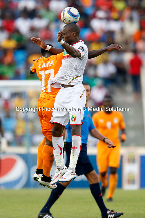 Bakary Soko of Mali Serge Alain Stephane of Cote d'Ivoire (L) in aerial contest against Yacoub Syla of Mali during their AFCON match at the Nueva Estadio de Malabo on January 24, 2015.The match ended 1-1.Photo/Mohammed Amin/www.pic-centre.com (Equatorial Guinea)