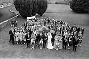 05/07/1967<br /> 07/05/1967<br /> 05 July 1967<br /> Wedding of George Walsh, eldest son of Mr and Ms Kevin G. Walsh, St. Rita's, Firhouse Road, Templeogue, Co. Dublin and Miss Arlene McMahon, elder daughter of Det. Chief Supt. Philip McMahon, Head of Special Branch, Dublin Castle and Mrs McMahon of Lisieux, Templeville Park, Templeogue, Co. Dublin who were married at the Carmelite Church, Terenure College, Dublin. An Taoiseach Mr Jack Lynch and Mrs Lynch; Mr Liam Cosgrave, leader Fine Gael and Mrs Cosgrave were among the 120 guests. Rev Fr H.E. Wright, O. Carm., Moate, officiated at the ceremony. The reception was held at Downshire Hotel, Blessington, Co. Wicklow. View of the wedding party in the garden of the hotel.