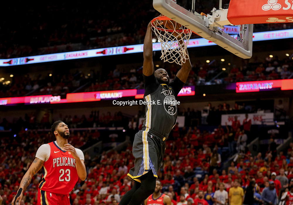 May 4, 2018; New Orleans, LA, USA; Golden State Warriors forward Draymond Green (23) dunks past New Orleans Pelicans forward Anthony Davis (23) during the first quarter in game three of the second round of the 2018 NBA Playoffs at Smoothie King Center. Mandatory Credit: Derick E. Hingle-USA TODAY Sports