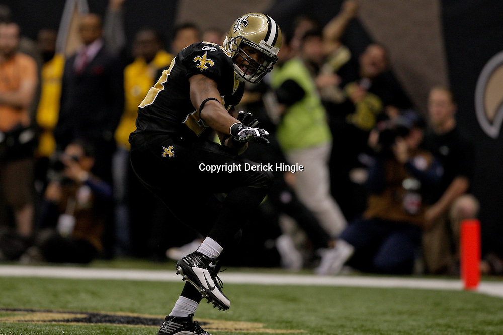 2009 November 02:  New Orleans Saints running back Pierre Thomas (23) celebrates following a touchdown in the first quarter against the Atlanta Falcons at the Louisiana Superdome in New Orleans, Louisiana.