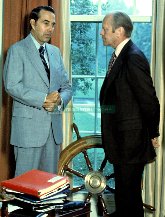 United States President Gerald R. Ford, right, meets with his running mate, US Senator Bob Dole (Republican of Kansas), left, the GOP nominee for Vice President of the United States, in the Oval Office of the White House in Washington, DC on October 1, 1976.<br /> Credit: Barry A. Soorenko / CNP