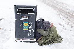 "© Licensed to London News Pictures. 28/02/2018. <br /> <br /> A homeless person shivers in the cold as Glasgow, Scotland is hit with snow storm ""Beast from the East"" on 28th February 2018.<br /> <br /> Photo credit should read Max Bryan/LNP"
