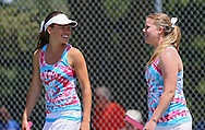 Urbandale's Michelle Van Roekel (from left) and Madeline Heer talk at the beginning of the finals for the Doubles Draw of the Class 2A state tennis tournament at Veterans Memorial Tennis Center in Cedar Rapids on Friday, May 31, 2013.