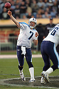 OAKLAND, CA - DECEMBER 19:  Quarterback Billy Volek #7 of the Tennessee Titans had the second best passing day in franchise history, completing 40 of 60 passes for 492 yards and 4 touchdown passes, while also running for another touchdown against the Oakland Raiders at Network Associates Coliseum on December 19, 2004 in Oakland, California. The Raiders defeated the Titans 40-35. ©Paul Anthony Spinelli *** Local Caption *** Billy Volek