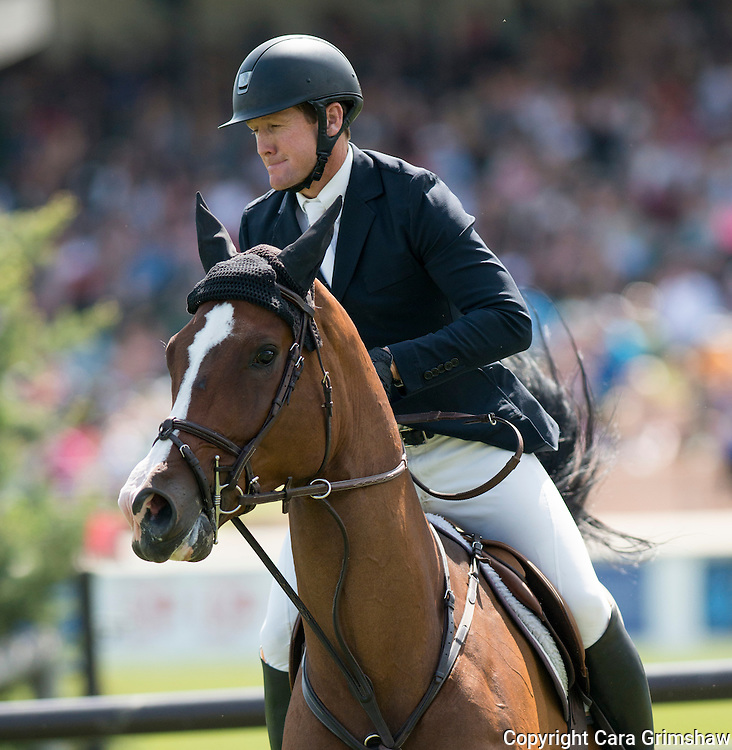 MCLAIN WARD (USA) rides TROYA RETIRO in the 1.50m Derby Nexen Cup during National CSI 5* at Spruce Meadows presented by Rolex, June 7 2015. Calgary.