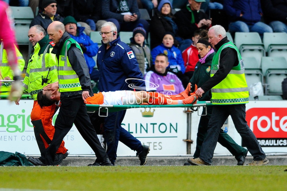 Luton Town's Dan Potts is stretchered off after being injured during the Sky Bet League 2 match between Plymouth Argyle and Luton Town at Home Park, Plymouth, England on 19 March 2016. Photo by Graham Hunt.