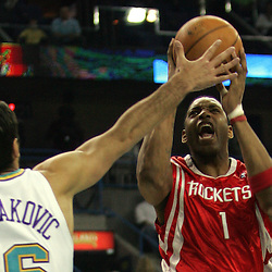 Houston Rockets guard Tracy McGrady #1 shoots as New Orleans Hornets forward Peja Stojakovic #16 defends  in the first quarter of their NBA game on March 19, 2008 at the New Orleans Arena in New Orleans, Louisiana.